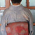 橘模様の織名古屋帯に染紬の小紋